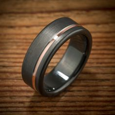Men's Offset Rose Gold Stripe Black Zirconium Wedding Band made by Spexton.com Male Wedding Bands, Wedding Ring For Men, Groom Wedding Rings, Black Gold Wedding Rings, Groom Ring, Unique Mens Wedding Bands, Matching Wedding Rings, Bridal Rings, Wedding Rings Simple
