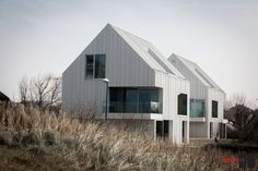 Image 1 of 29 from gallery of Blanco Oostduinkerke Residence / BURO II & ARCHI+I. Photograph by Thomas de Bruyne Roof Architecture, Commercial Architecture, Modern Barn, Modern Farmhouse, Roof Design, House Design, Habitat Groupé, Fibreglass Roof, Duplex House