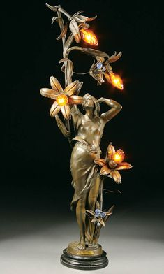 "bronzed figural lamp French, circa ""Le Revel"" depicting a woman grasping a lily form branch with four lights on a black marble plinth Art Nouveau Interior, Art Nouveau Furniture, Art Nouveau Design, Victorian Lamps, Antique Lamps, Antique Lighting, Belle Epoque, Alphonse Mucha Art, Jugendstil Design"