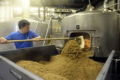 Sixpoint brewer Craig Frymark empties the mash tun by *Sixpoint*, via Flickr