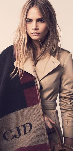 Cara Delevingne wearing a cashmere blanket poncho, on the Burberry Autumn/Winter 2014 campaign set - monogrammed