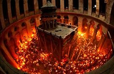"The Holy Fire (Greek Ἃγιον Φῶς, ""Holy Light"") is described by Orthodox Christians as a miracle that occurs every year at the Church of the Holy Sepulchre in Jerusalem on Great Saturday, or Holy Saturday, the day preceding Orthodox Easter. La Résurrection Du Christ, Holy Saturday, Orthodox Easter, Saint Esprit, Orthodox Christianity, Chapelle, Place Of Worship, Holy Land, Jerusalem"