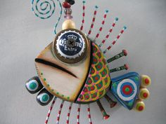 mosaic walls with found objects | One of Kerry Heath's Twisted Fish