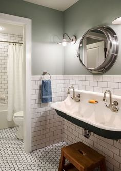 "Soho White subway tile 3 X 6 on wall and Soho White 2"" hexagons on floor with dark grout"