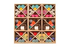 This is what yarn store storage looks like. Could add the X dividers to my existing shelving boxes.