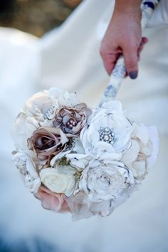 the brooch bouquet, while gorgeous and sparkly, is a little bit pricey.  Silk flowers are also a little pricey. So I'm making my own fabric flowers, purchasing some fancy buttons to create a similar look to this bouquet! love it!!