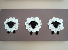 Three button sheep create a textured wall hanging for your little ones bedroom or nursery. Sheep are made of black and white buttons and stand
