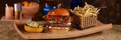 The Barrel Burger- crisp pancetta, aged provolone, caramelized onions, tomato jam, basil aioli, jarred pickled vegetables