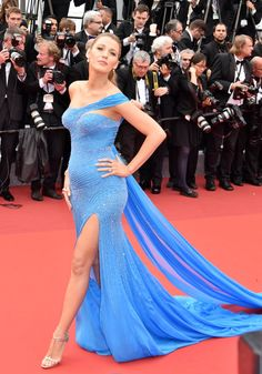 Pin for Later: Blake Lively's Maternity Style Is Straight-Up Glamour  The actress revealed her burgeoning bump in a skintight Versace gown at Cannes in May.