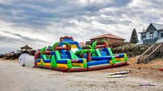 Florida- Two giant inflatable slides: zorb balls and motorized surfboards, located in New Smyrna Beach