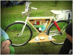 We don't advocate drinking and riding, but when used with common sense (ahem, w/o alcohol) this DIY Bicycle Bar Cart is sure to be the talk of your neighborhood cook-out! Love the hinged table that is propped up by the kickstand, and the cutouts/indentations for drink holders. http://www.buzzpatrol.com/
