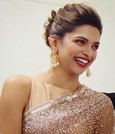 Deepika's hairstyle - classic indian bun with a gajra ...