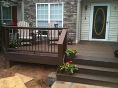 I like the idea of a small railing on part of the deck - but not ...
