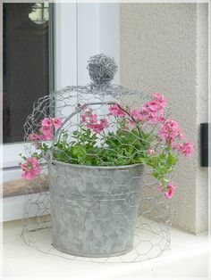 wire cloche and galvanized bucket of flowers