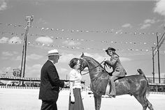nice [Contestant Receiving Award Ribbon, Breed Show Schooling Event, Pin Oak Charity Horse Show]
