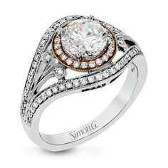 This beautiful vintage-inspired ring has a wonderful low profile and is crafted from 18k white and rose gold. It contains .44 ctw of round brilliant white diamonds. Print Page