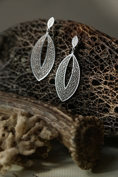 A personal favorite from my Etsy shop https://www.etsy.com/listing/602376255/drop-filigree-earring