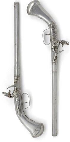 Pair of iron-stocked rifled turn-off flintlock pistols  by Johann Krach  Maastricht (?)  circa 1665