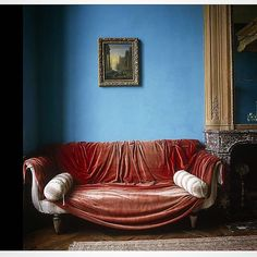 Sofa with a red velvet cover captured by photographer Simon Upton