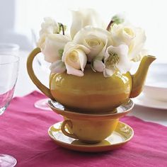Amazing idea for the centerpieces!! Of course I would like the teapots /teacups to be a little more colorful and cutesy. As well as a prettier color flower. I wonder if I couldn't find the dishes at garage sales or goodwill to make this really inexpensive!?
