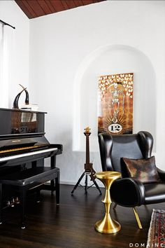 """Modern lighting and patterned tile injected a bit of edge into the classic Spanish-style of the home—not to mention Trohman's collection of musical equipment. """"Aesthetics are..."""