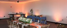 First Class Weddings Uplighting is still affective in the daytime, showing off some orange blends to match the table settings!  Visit our website to view our FCW Team and all of the Services we have to offer!  www.fcweddings.com    #FirstClassWeddings #FCW #Uplighting #BostonUplighting #WeddingUplighting #BostonWedding #SummerWedding #orangeUplighting #SkylineRoom #Museum #Science
