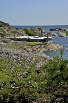 The Summer House, designed by architecture firm Jarmund/Vigsnæs Architects is located on the coast of Vestfold in the southern part of Norway.