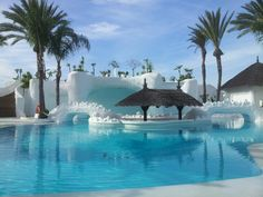 Albayzin del Mar pool with party cave disco right behind it