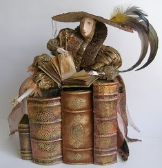 Reading Dolls by Russian artist Lada Repina. What amazing detail and she clearly exudes an appreciation of books.