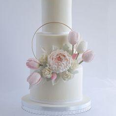 Wedding Cake A hoop wedding cake with a sugar peony and tulips.