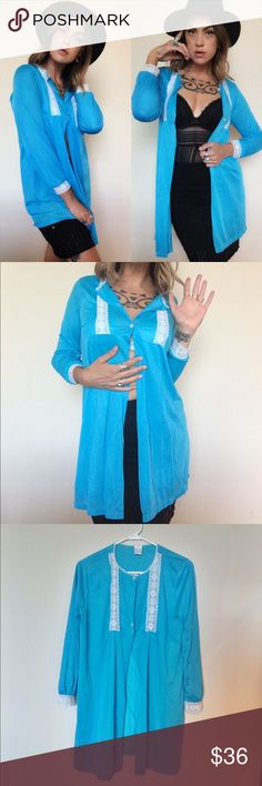 """Shades of cool"" vintage silky kimono/mini gown Gorgeous, silky, vibrant turquoise kimono/ mini gown. Originally intended to be a long sleeved teddy, this beautiful piece has a three button closure near the bust and neck (one button is missing as pictured), but looks best worn open kimono style. This also looks kick ass with just one button closed right at the bust. Lave detail and front and cuffs. Size medium Vintage Tops Tunics"