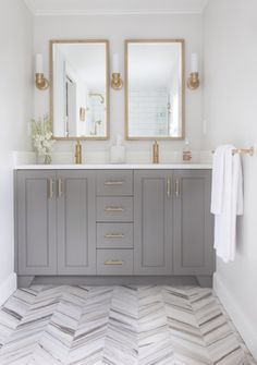 love the floor, gray vanity and brass finishing touches.