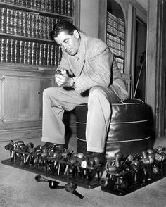 Glenn Ford and his pipe collection...reminds me of my Daddy, looks wise and his pipe collection. I will be forever drawn to the smell of cherry vanilla pipe tobacco :)