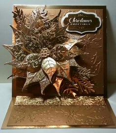 Card shared by Tom Gringas on Anna Griffin's Facebook page Sunday share 12/11/16. Botanical dies and lots of gold paper. Spectacular!