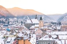 Sunset views over the pastel town of Brasov, Transylvania, Romania
