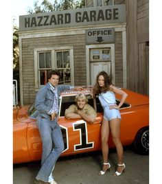 Bo, Luke and Daisy Duke - with automotive co-star the General Lee - in the Dukes of Hazzard