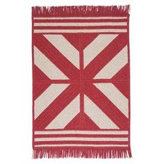 Braided and reversible wool-blend rug with a Southwestern motif and fringe trim. Made in the USA.