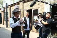 Johnny and DMG CEO Dan Mintz talk film while strolling through a Beijing hutong