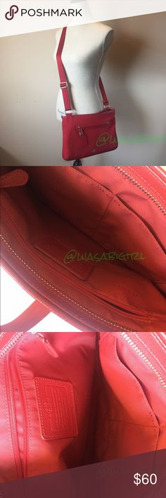 """Red Coach Crossbody Purse Adjustable shoulder strap to wear one shoulder at higher hip. Measures about 13""""L x 9.5""""H. Canvas bag in deep red with leather tags and loops. No fraying on purse strap. Small mark on front above Coach emblem, slight wear marks on bag of bag and back pocket opening by magnet. Marks can probably cleaned easily with soap and water or purse cleaner. Magnet closure on back pocket never really strong that it must be pryed open. Front pocket has zipper and latch for safe…"""