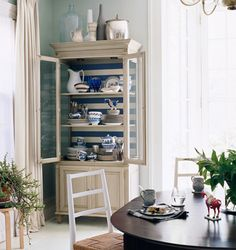 I love the stripes on the back of this armoire!