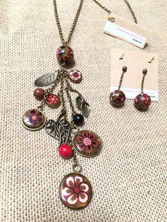 Conjunto en bronce, rojos y negro, diseño Sonia de la Torre https://www.facebook.com/TOCADORDEMACA/photos/pcb.885921914886431/885921648219791/?type=3