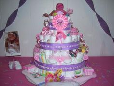 This bright & happy diaper cake is a delightful centerpiece for a girl theme baby shower, as you can see in both photographs above. A diaper cake can bring
