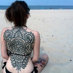 45 Superb Back Tattoo Designs For Men and Women
