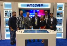 The Encore Event Technologies team at #HITEC14 in our custom booth.