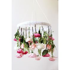 Deck out your dining room in flowers from the floor all the way to the ceiling with a flower chandelier DIY.