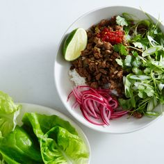 Thumbs up! Chicken larb. This 30-minute larb is crunchy, salty, spicy, and everything we want to eat tonight.