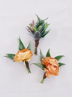 Flowers by Lace and Lilies, mens boutonniere, thistle, ranunculus, fern, bay leaf, calcynia. Colorful summer wedding flowers