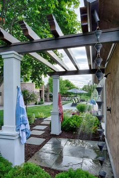 Don't you love this outdoor shower?   HGTV >> http://www.hgtv.com/design-blog/outdoors/pretty-patio-pavers?soc=pinterest