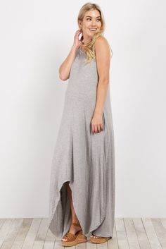 Classic solid hues and hi low hemlines are super cute and chic for this season. This maternity dress features a crisscross back detail and a unique hi low hemline. Style this dress with cute neutral wedges and a denim jacket for a complete look.