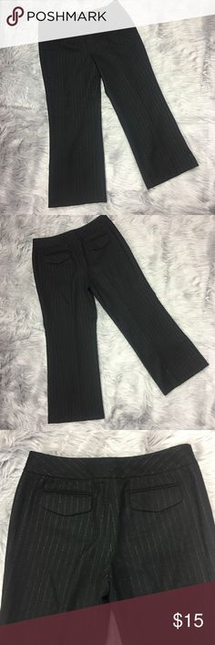 "Ann Taylor 12P Black Pinstripe Dress Pants Ann Taylor 12P Black Wool Pinstriped Lined Dress Pants Career Work Wear  Nice Pre-Owned Condition, No Stains, Small tear at seam of liner, does not affect wear, see pic, 2 faux back pockets.   *Measurements are taken with garments laid flat and unstretched, please compare to your own garments for best fit*  Waist: 17""  Rise: 12""  Inseam: 25""   A-3 Ann Taylor Pants Trousers"